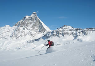Instructor-led ski courses below the Matterhorn, April powder snow